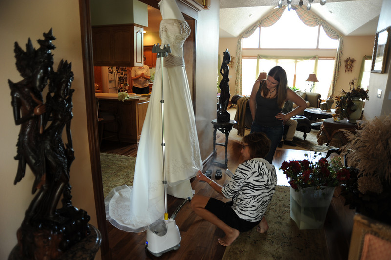 Kim and Michelle check on the wedding dress.