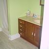 Upstairs bathroom, vanity and shower.