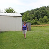 Teresa on side of house, big garage on property as well.