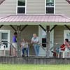 Teresa, Sug, Mom, and Irma Gayle on the porch of Doug's potential new home.