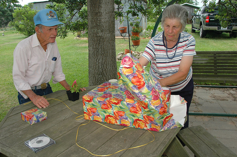 Tex & Earline opening the combination Mother's Day and Father's Day present.