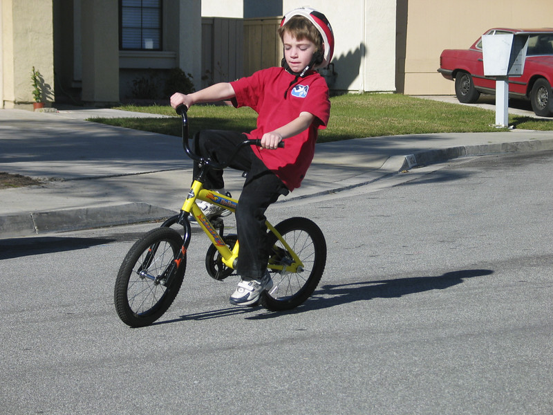 Trevor riding a bike without training wheels for the first time