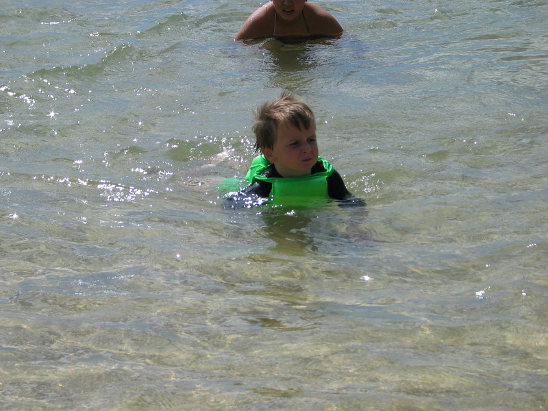 Neil swimming by himself in the ocean.