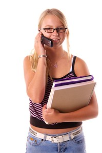Stylish middle school student with text books talking on a cell phone  Isolated over white