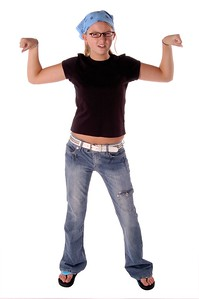 Young girl showing off her muscles  Isolated over white