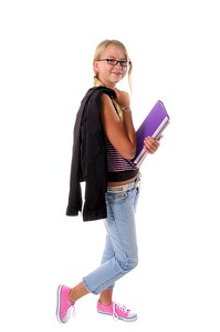 August means Back To School,  Stylish young  Middle School student walking with hercoat over her sholder and text books in her arm   isolated over white.