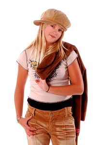 Young girl in cuteschool cloths with her jacket over her shoulder