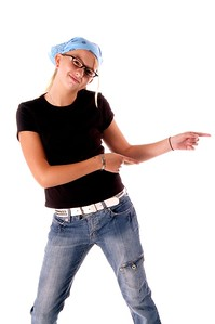 Young girl disco dancing pointing the way  Isolated over white