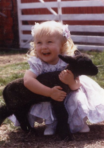 Kyla Sage in her Easter dress at the farm in Vincennes, Indiana.    Might have been taken in 90 or 91.  She was taken away from us in July of 1991.  We still miss her.