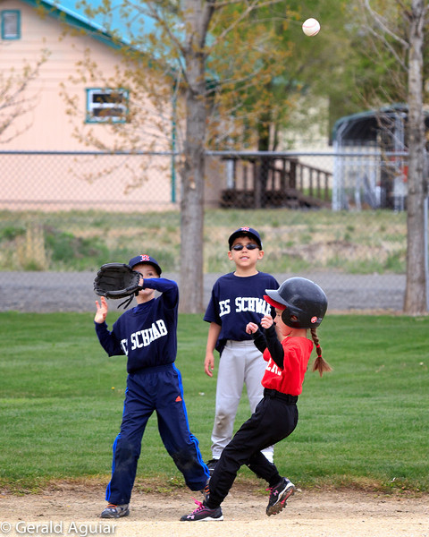 Kyle trying to catch the ball to tag the runner out at second base