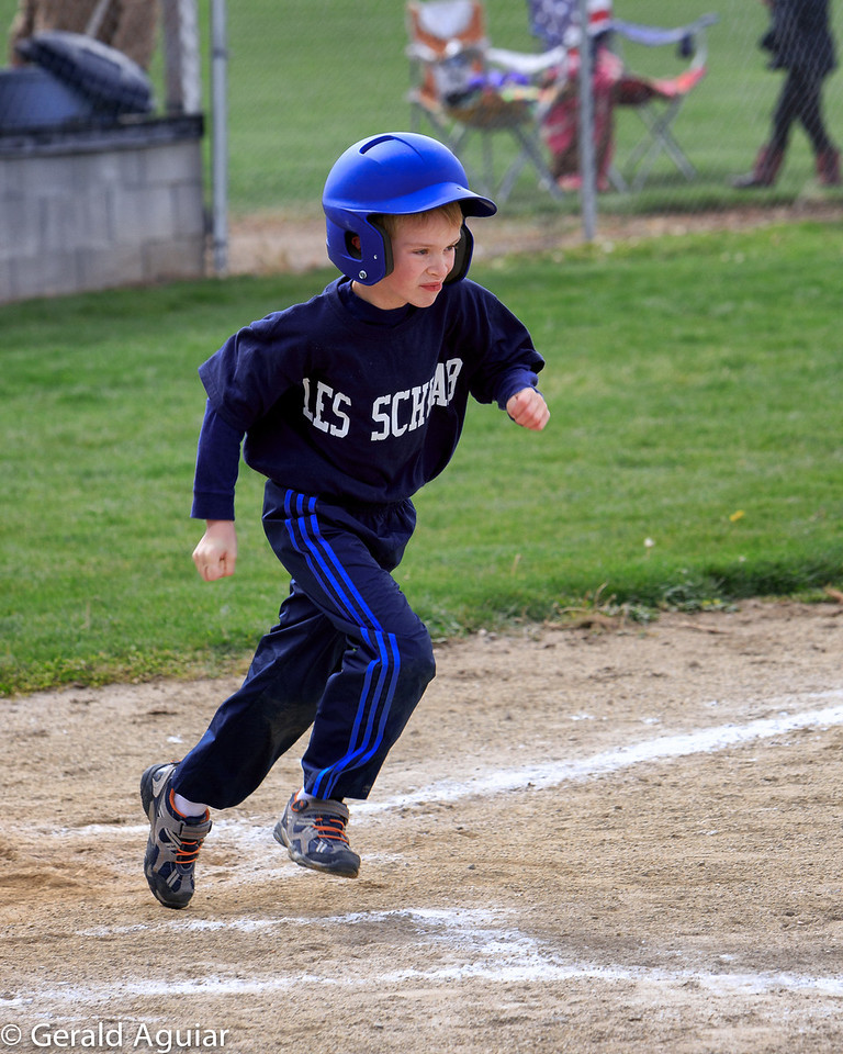 Kyle running to first base