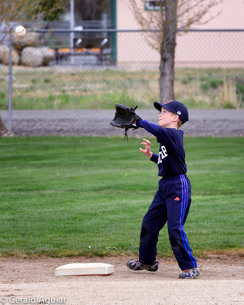 Kyle going after a ball thrown to second base