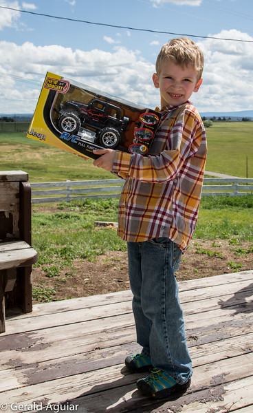 Kyle holding his new remote control car given to him from his aunt Kristin.