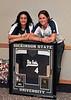 "Nathalie Martinez and Sara Jane ""S.J."" Webster with Ashley Neufeld's retired jersey."