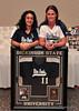"Nathalie Martinez and Sara Jane ""S.J."" Webster with Kyrstin Gemar's retired jersey."