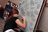 Coach Kristen Fleury writes a memory note on the back of Ashley Neufeld's photo montage.