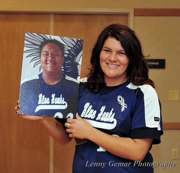 Charnel Zetsch holding the DSU PR photo of Kyrstin Gemar.