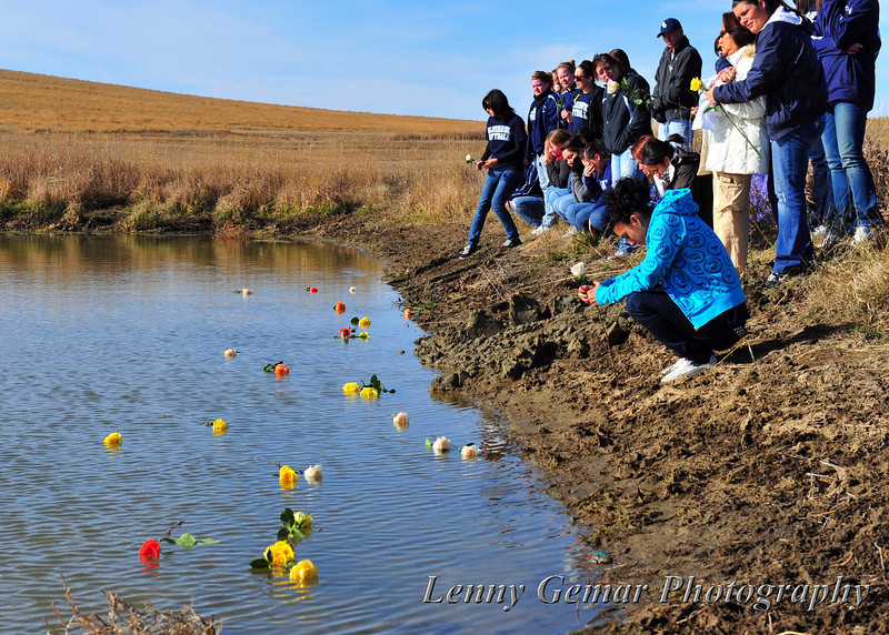 As team members gently toss roses into the pond, Nathalie Rodriguez mourns the loss of her friends.