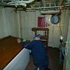 Bill Mason works on restoring the radio room