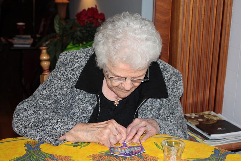 MOM IS SCRATCHING A BINGO CARD.  WONDER IF SHE WON!!