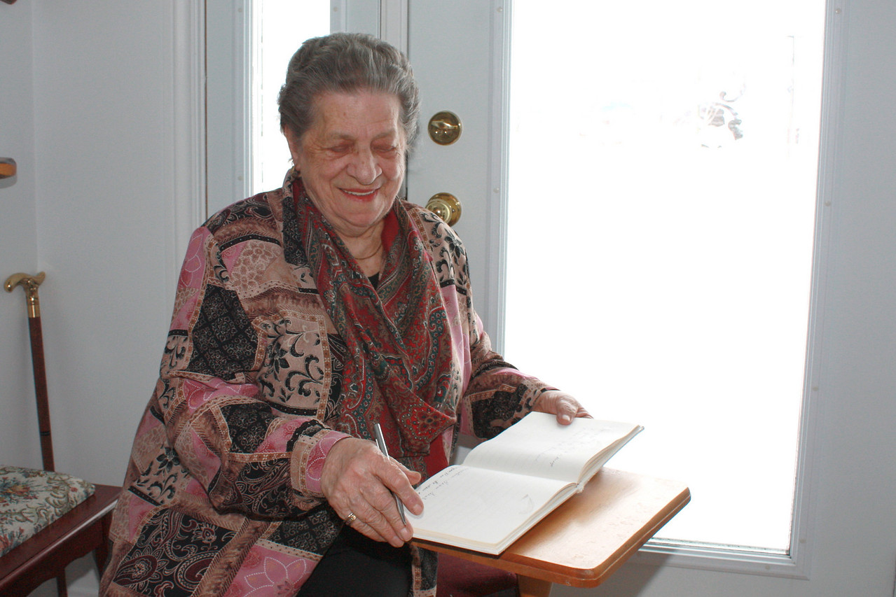 THERESE SIGNING THE GUEST BOOK