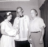 Godparents Anna Mae (holding Rick) and August Lehman, with father Quirk.