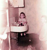 Sherri, December 1956, with Michael on blurred right