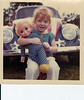 This my Angie, when we first met 1972. She is holding a Mrs. Beasley Doll, don't know what happened to it. The VW in the background belonged to another airman who was shipped over to Vetnam on short notice we were looking after it. It was hand painted - far away it looked pretty, good up close badddd!