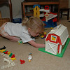 Little farmer organizing her little barn.