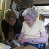Fran Knechel with her grandmother, Anna Ruth while looking at a memory picture book.
