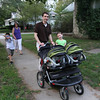 A sidewalk full of Sweitzers - two twins in a carriage followed by Jason and Hannah and then Leo and JoAnn.