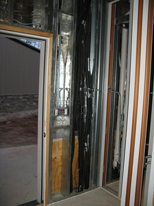 Utility room, south wall. The insulated pipes are the water lines for the geothermal AC system.