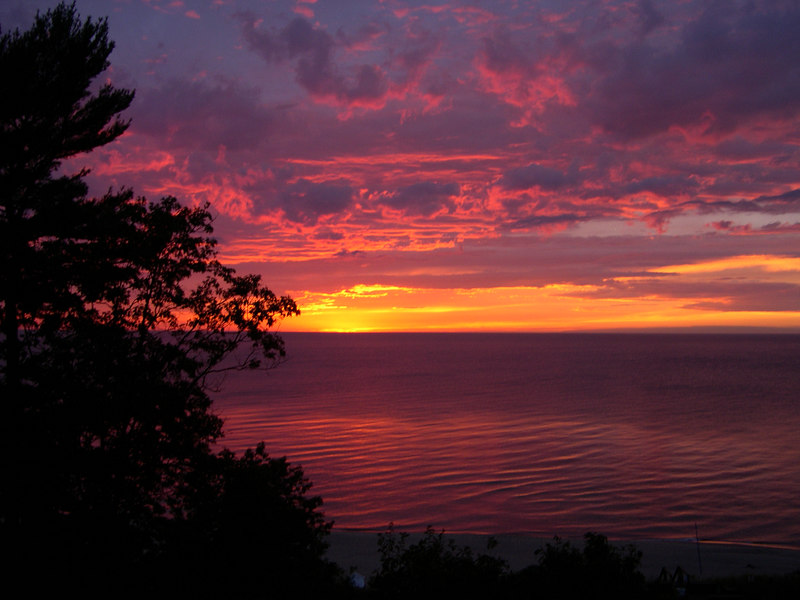 A beautiful sunset over Lake Michigan, from the deck of our cottage at Thunder Mountain.