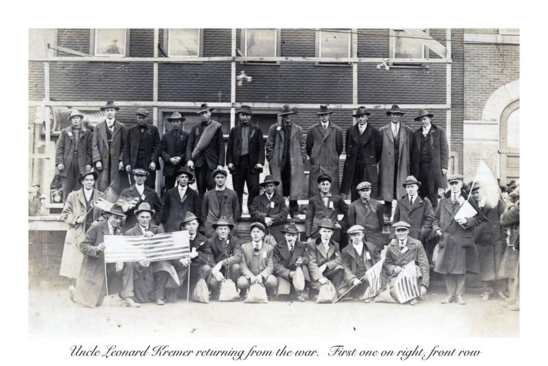 Uncle Leonard Kremer returning from the war.  First one on right, front row