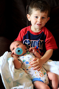 Justin holding his baby brother,Landon 7-8-2012.