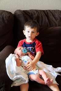 Older brother,Justin, holding Landon 7-8-2012.