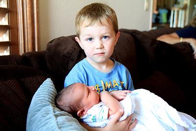 Older brother,Brayden, holding baby Landon 7-8-2012.