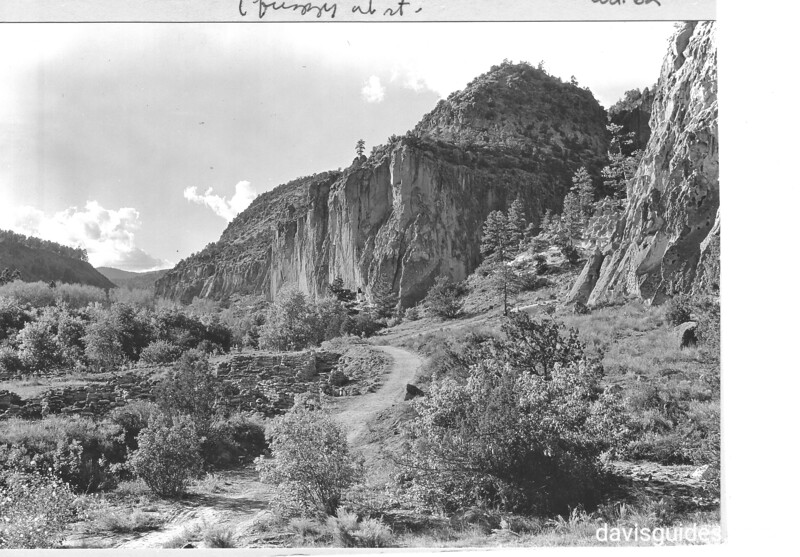 View of Frijoles Canyon from floor near headquarters showing part of surface rim on Tyuonyi in foreground, 1934