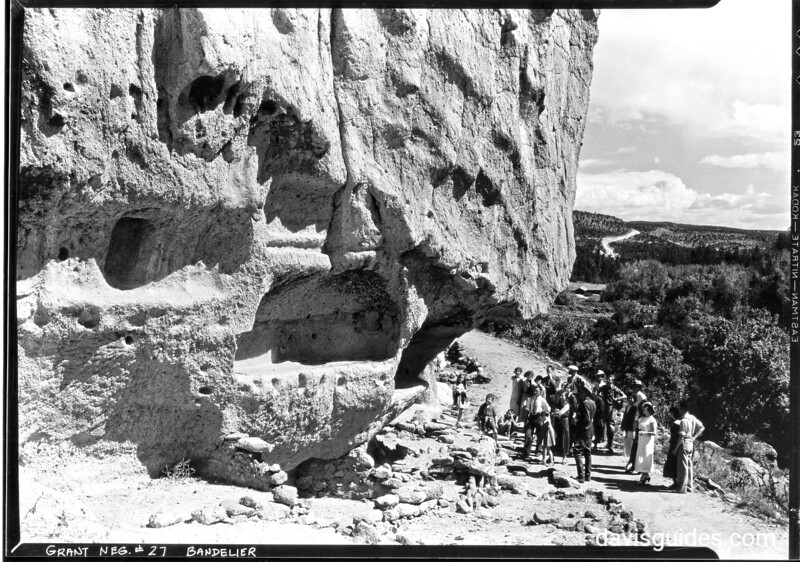 Ranger guided tour of cliff dwellings in Frijoles Canyon, Bandelier NM, 1934