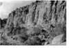 View up Frijoles Canyon showing tufa cliffs along north wall. 1934