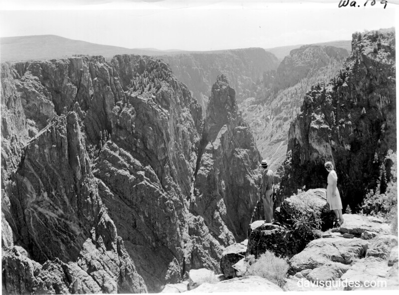 "Tourists view the Gunnison River from the South Rim. The pinnacles are called ""Island Peaks"". Black Canyon of the Gunnison National Park, 1935"