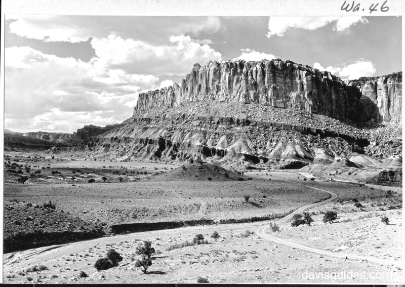 View west along Wayne Wonderland Cliffs, showing entrance to Capitol Wash at right. Capitol Reef National Park, 1935