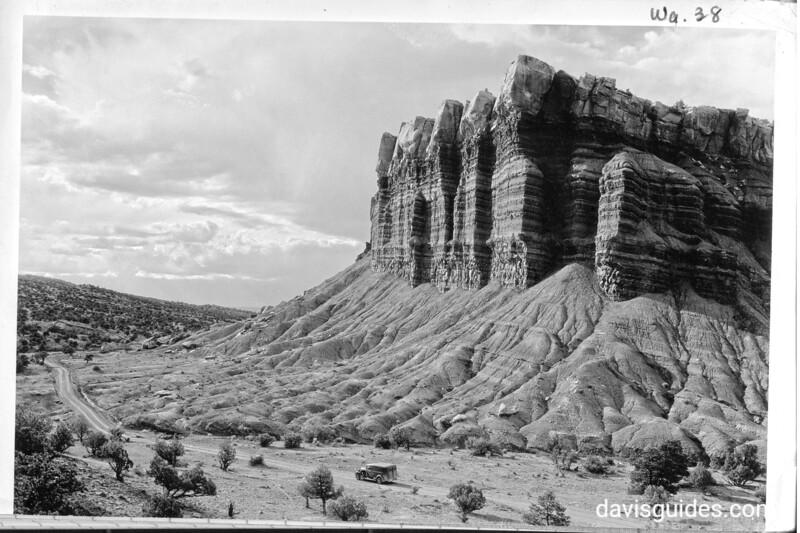 """The Great Organ, Capitol Reef National Park, 1935. Grant's panel truck the """"Hearse"""" in the foreground."""