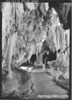 """Large blade shaped onyx drape, known as the """"Guillotine"""" in the King's Palace, Carlsbad Caverns National Park, 1934."""
