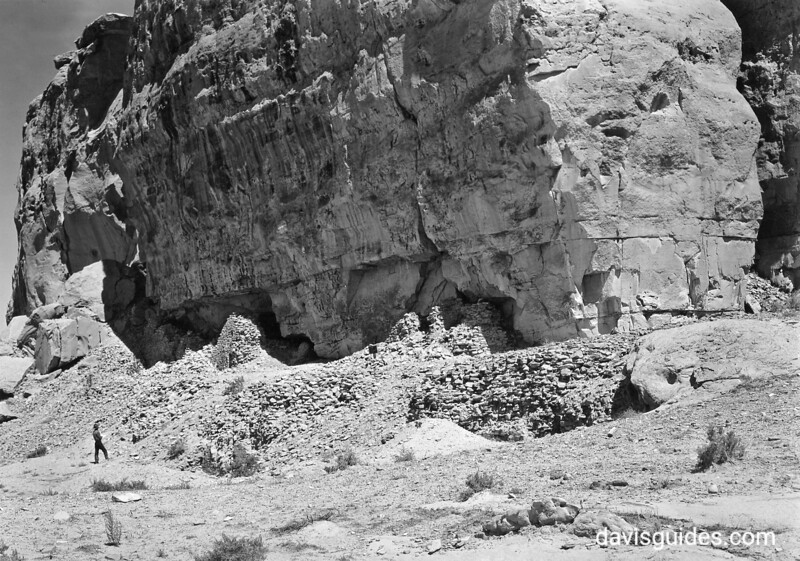 A visitor examines the ruins of ancient structures. Chaco Canyon National Monument (now Chaco Culture National Historical Park), 1934