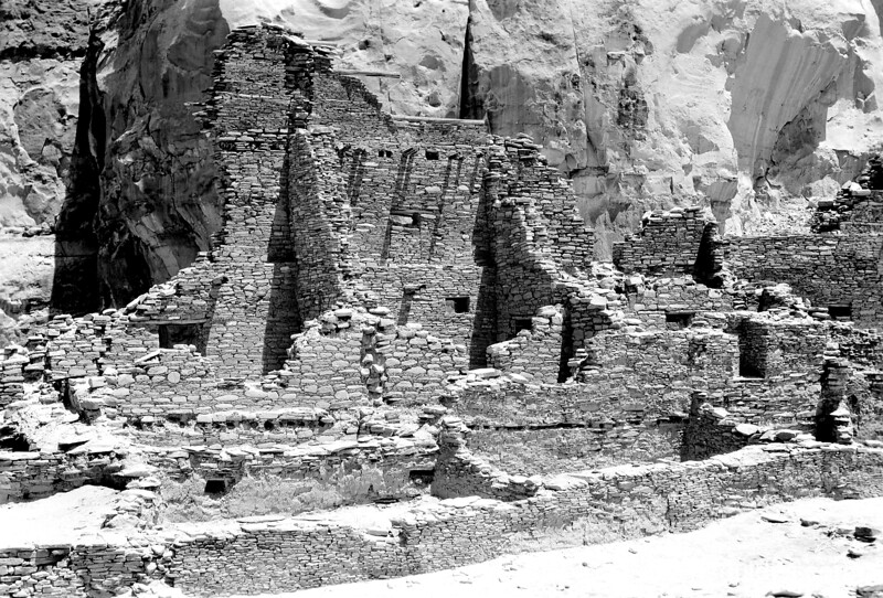 High part of the west end of the North Wall of Pueblo Bonito showing rooms inside with at least four different methods of layering stone. Chaco Canyon National Monument (now Chaco Culture National Historical Park), 1929.