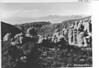 Over wonderland of rocks in Balance Rock area can be seen Upper Sulphur Springs Valley and Cabezon Peak in the distance, Chiricahua National Monument, 1935.