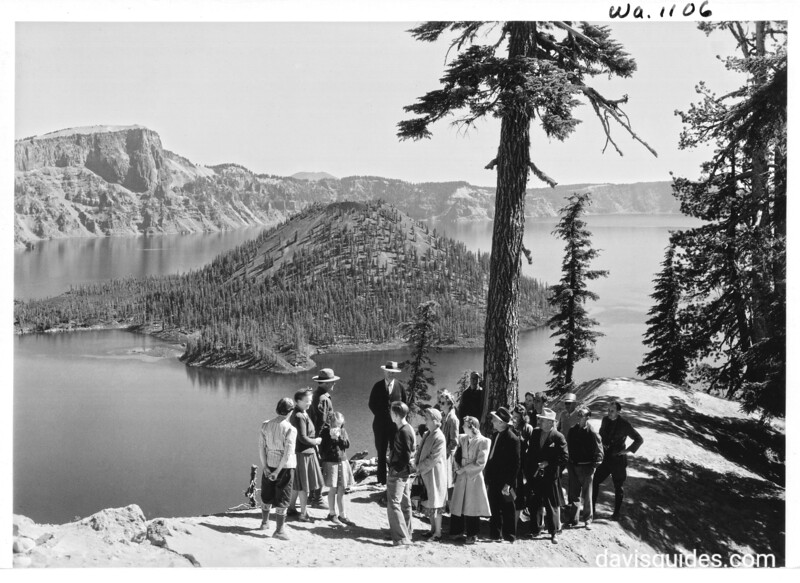 Ranger naturalist with visitors on rim of Crater Lake, Crater Lake National Park, 1941.