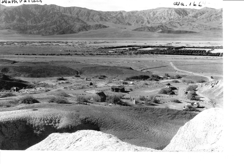 Texas Springs public automobile campground showing outline of Furnace Creek Ranch in center of the valley, Death Valley National Park, 1935.