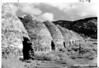 Old charcoal kilns near Thorndyke, high up Wildrose Canyon, Death Valley National Park, 1935.